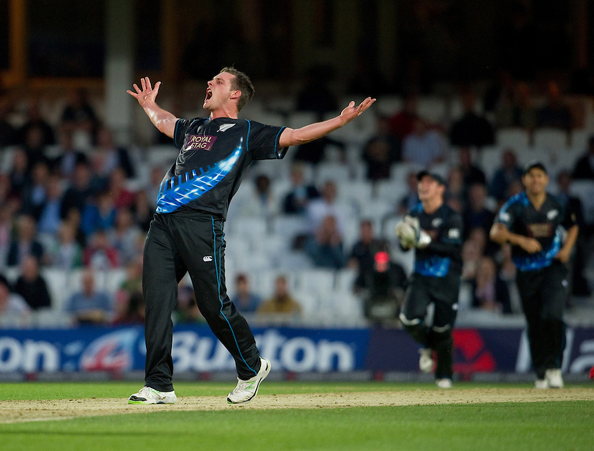 New Zealand's Mitchell McClenaghan celebrates taking the wicket of England's Luke Wright <br /> <br />  (Photo by Ashley Western/CameraSport) <br /> <br /> International Cricket - NatWest International T20 Series - England v New  Zealand - Tuesday 25th June 2013 - The Kia Oval, London <br /> <br />  &copy; CameraSport - 43 Linden Ave. Countesthorpe. Leicester. England. LE8 5PG - Tel: +44 (0) 116 277 4147 - admin@camerasport.com - www.camerasport.com