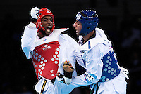 04 DEC 2011 - LONDON, GBR - Toran Maizeroi (FRA) (in red, on left) battles with Josef Al-Zubeidy (SWE) (in blue, on right) during their men's -80kg category preliminary round contest at the London International Taekwondo Invitational and 2012 Olympic Games test event at the ExCel Exhibition Centre in London, Great Britain .(PHOTO (C) NIGEL FARROW)
