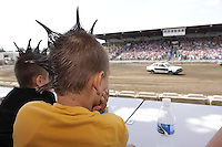 Ethan Jones 5, and brother Andrew, 10, of Everson, watch the Demolition Derby at the NW Washington Fair. August 17, 2009 PHOTOS BY MERYL SCHENKER ..         ....schenker IMG_4472.JPG