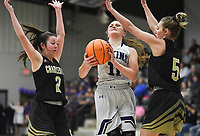 Elkins Ashley Brink (11) drives the ball past Charleston guard Brooklyn Groen (2) and guard Baylee King (5), Friday, February 14, 2020 during a basketball game at Elkins High School in Elkins. Check out nwaonline.com/prepbball/ for today's photo gallery.<br /> (NWA Democrat-Gazette/Charlie Kaijo)