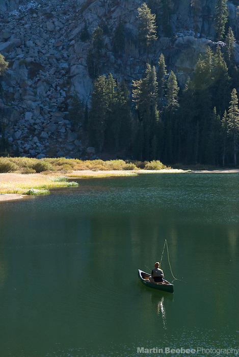 Fisherman in canoe on Woods Lake, El Dorado National Forest, California