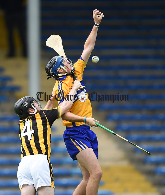 Luke Hickey of Kilkenny in action against Darragh Corry of Clare during their Intermediate All-Ireland final at Thurles. Photograph by John Kelly.