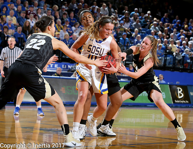 BROOKINGS, SD - MARCH 19:  Kerri Young #10 from South Dakota State is tied up for a jump ball between a trio of defenders including Haley Smith #22 from Colorado during their second round WNIT game at Frost Arena March 19, 2017 in Brookings, South Dakota. (Photo by Dave Eggen/Inertia)