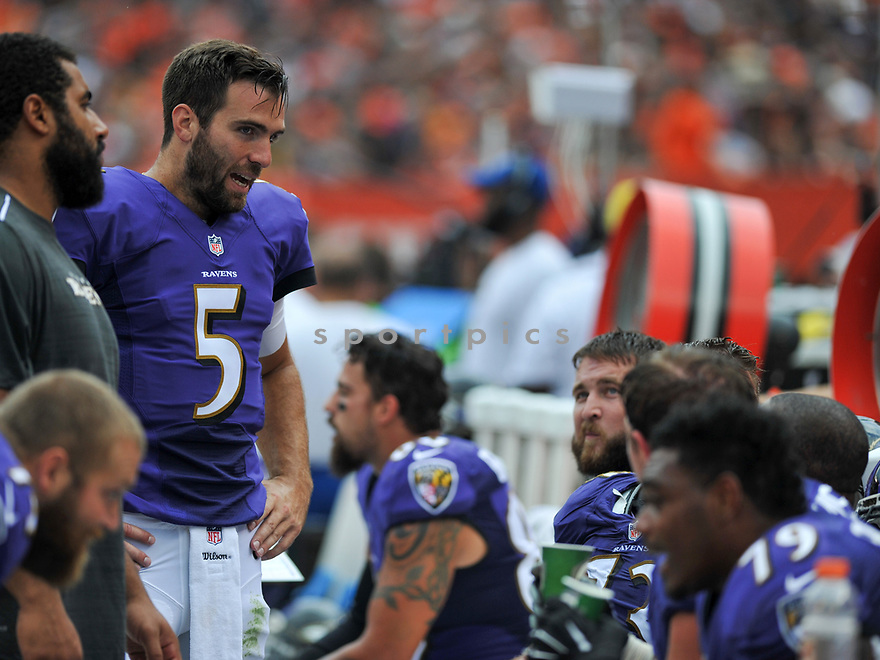 CLEVELAND, OH - JULY 18, 2016: Quarterback Joe Flacco #5 of the Baltimore Ravens talkes with the offensive line on the sideline in the second quarter of a game against the Cleveland Browns on July 18, 2016 at FirstEnergy Stadium in Cleveland, Ohio. Baltimore won 25-20. (Photo by: 2017 Nick Cammett/Diamond Images)  *** Local Caption *** Joe Flacco(SPORTPICS)