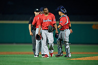 Pawtucket Red Sox pitcher Jenrry Mejia (48) walks away with catcher Juan Centeno as manager Billy McMillon (51) argues a call with umpire Dan Merzel during an International League game against the Rochester Red Wings on June 28, 2019 at Frontier Field in Rochester, New York.  Pawtucket defeated Rochester 8-5.  (Mike Janes/Four Seam Images)