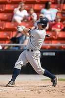 Second baseman Justin Snyder (3) of the Charleston RiverDogs follows through on his swing versus the Hickory Crawdads at L.P. Frans Stadium in Hickory, NC, Sunday, May 4, 2008.