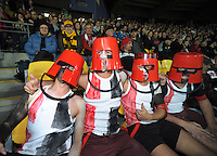 Buckethead St Kilda fans watch from the stand during the Australian Rules Football ANZAC Day match between St Kilda Saints and Sydney Swans at Westpac Stadium, Wellington, New Zealand on Thursday, 24 May 2013. Photo: Dave Lintott / lintottphoto.co.nz