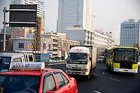 Traffic moves along the streets of Urumqi, Xinjiang, China.  Urumqi is a major link on the so-called New Silk Road, a transportation network facilitating international trade between China, Central Asia, and beyond.