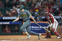 Nick Loftin (2) of the Baylor Bears follows through on his swing against the Arkansas Razorbacks in game nine of the 2020 Shriners Hospitals for Children College Classic at Minute Maid Park on March 1, 2020 in Houston, Texas. The Bears defeated the Razorbacks 3-2. (Brian Westerholt/Four Seam Images)