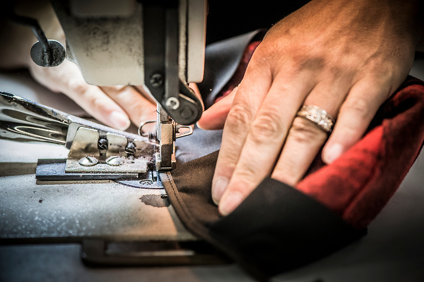 A step in the Stormy Kromer manufacturing process attaching the trim at the Ironwood, Michigan production facility.