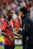 DaMarcus Beasley (16)  of the United States talks with assistant coach  Martin Vasquez. The men's national team of the United States (USA) was defeated by Ecuador (ECU) 1-0 during an international friendly at Red Bull Arena in Harrison, NJ, on October 11, 2011.