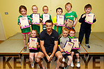 Ballyduff NS students, with thier Seachtain na Gaeilge certs pictured with Kerry footballer Shane Enright on his visit to the school on Thursday. Seated l to r: Aoife O'Rourke, Shane Enright, Kieran Walsh Lucid and Oisin O'Gorman.<br /> Back l to r: Kelsey Mannix, Orlaith Keane Frizelle, Katelyn Moriarty, Michael Leahy, Rory O'Sullivan and James O'Brien.