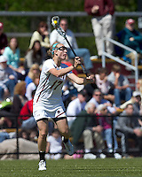 Boston College midfielder Mikaela Rix (17) passes the ball. Boston College defeated Yale University, 16-5, at Newton Campus Field, April 28, 2012.