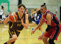Action from the 2017 AA Boys' Secondary Schools Basketball Premiership National Championship match between Kelston Boys' High School (red and blue) and Cashmere High School (burgundy and gold) at the B&M Centre in Palmerston North, New Zealand on Wednesday, 4 October 2017. Photo: Dave Lintott / lintottphoto.co.nz