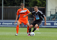Pictured L-R: Andrea Orlandi of Swansea against Lee Trundle of Neath. Saturday 17 July 2011<br />