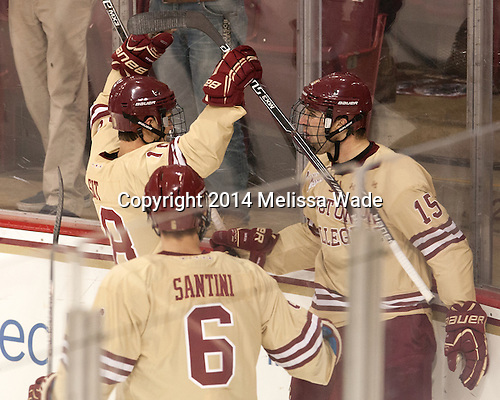 Michael Sit (BC - 18) and Steve Santini (BC - 6) celebrate Cam Spiro's (BC - 15) first goal of the game. - The Boston College Eagles defeated the visiting Colorado College Tigers 6-2 on Friday, October 24, 2014, at Kelley Rink in Conte Forum in Chestnut Hill, Massachusetts.