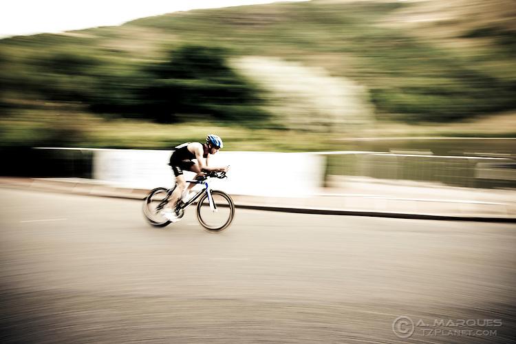 A cyclist at the 2010 GE Edinburgh ITU Duathlon World Championships, Edinburgh. Panning shot.