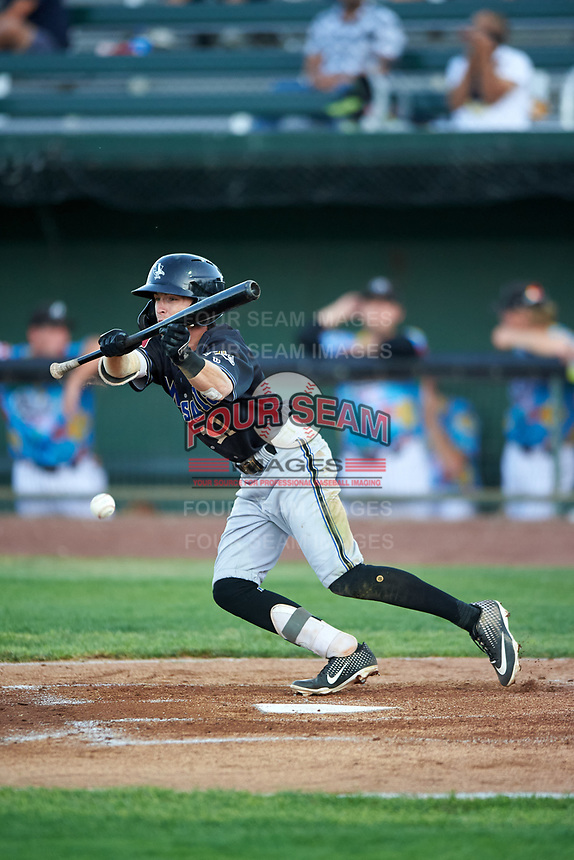 Missoula Osprey Cam Coursey (11) bunts during a Pioneer League game against the Idaho Falls Chukars at Melaleuca Field on August 20, 2019 in Idaho Falls, Idaho. Idaho Falls defeated Missoula 6-3. (Zachary Lucy/Four Seam Images)
