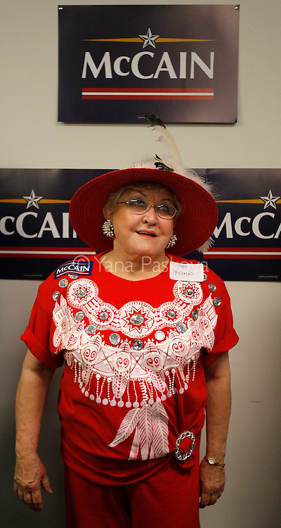 Nola Hirdman, volunteer for Republican Presidential hopeful John McCain (R-AZ) watches him speak in his first visit to Iowa since June. McCain held a press conference in his headquarters in Urbandale, IA, on July 22, 2007, where he declared his presidential campaign would go on, despite losing several aides and $1.7 million to debt.  He has already announced he will not attend the Republican Straw Poll in Ames, IA, on August 11, 2007.