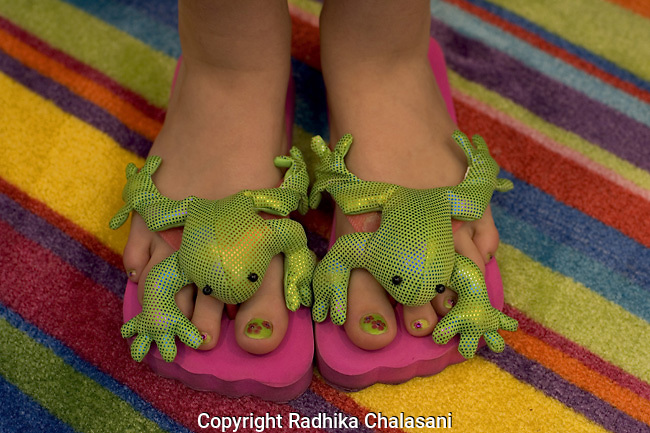 SAN ANTONIO, TEXAS-MARCH 25: Diandra Buckley (10) shows off her pedicure at Spaaht, the kids-only spa at the Hyatt Regency Hill Country Resort March 25, 2005 in San Antonio.The spa is one of a growing number across the U.S. catering to the teen and pre-teen age group and offering massages (40 USD), facials (40 USD), glitter manicures (30 USD), pedicures (35 USD) and hair braiding (3.50 USD/braid)     (Photo by Radhika Chalasani)