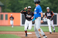 Aberdeen IronBirds second baseman Kirvin Moesquit (9) chases Matt Eureste (20) of the Hudson Valley Renegades back towards first base during the New York Penn League game at Leidos Field at Ripken Stadium on July 27, 2017 in Aberdeen, Maryland.  The Renegades defeated the IronBirds 2-0 in game one of a double-header.  (Brian Westerholt/Four Seam Images)