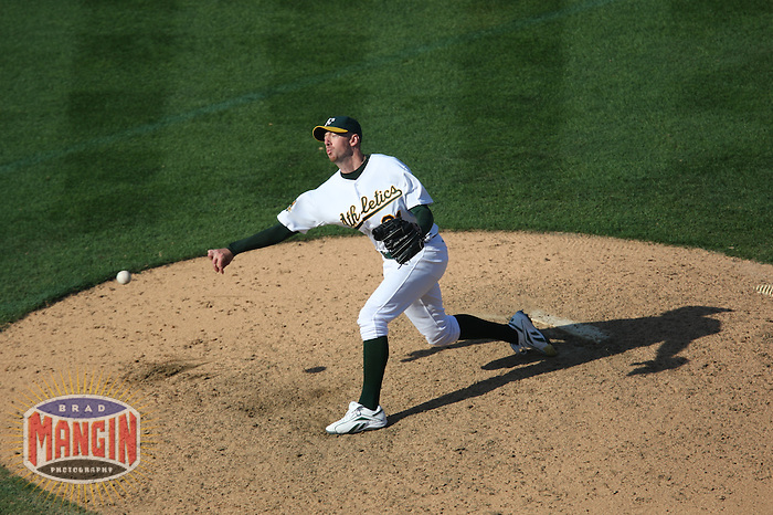 OAKLAND, CA - SEPTEMBER 14:  Brad Ziegler of the Oakland Athletics pitches during the game against the Texas Rangers at the McAfee Coliseum in Oakland, California on September 14, 2008.  The Athletics defeated the Rangers 7-4.  Photo by Brad Mangin