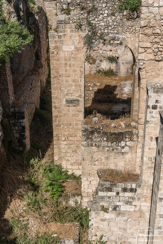 Supports for a Byzantine church stand in one of the ruins of the Pools of Bethesda next to the Church of Saint Anne in the Muslim Quarter of the Old City of Jerusalem.  The Old City of Jerusalem and its Walls is a UNESCO World Heritage Site.