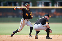 Pittsburgh Pirates Ji-Hwan Bae (56) throws to first base during a Florida Instructional League game against the New York Yankees on September 25, 2018 at Yankee Complex in Tampa, Florida.  (Mike Janes/Four Seam Images)