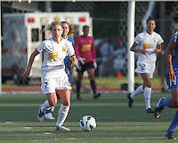 Western New York Flash midfielder McCall Zerboni (7) brings the ball forward.  In a National Women's Soccer League Elite (NWSL) match, the Boston Breakers (blue) tied Western New York Flash (white), 2-2, at Dilboy Stadium on June 5, 2013.