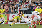Simon Kennewell of Australia knocks down Will Glover of England during the match Australia vs England, the Bronze Final of Day 2 of the HSBC Singapore Rugby Sevens as part of the World Rugby HSBC World Rugby Sevens Series 2016-17 at the National Stadium on 16 April 2017 in Singapore. Photo by Victor Fraile / Power Sport Images
