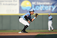 Hickory Crawdads second baseman Jonathan Ornelas (3) takes a throw from the catcher prior to the start of an inning during the game with the Augusta GreenJackets at L.P. Frans Stadium on April 24, 2019 in Hickory, North Carolina.  The Crawdads defeated the GreenJackets 5-4. (Tracy Proffitt/Four Seam Images)