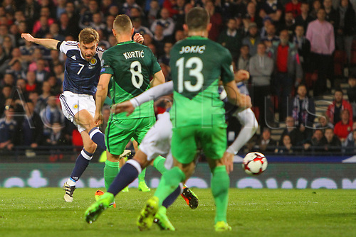 March 26th 2017, Hampden Park, Glasgow, Scotland; World Cup 2018 qualification football, Scotland versus Slovenia;  James Morrison shoots past Kurtic and Jokic of Slovenia