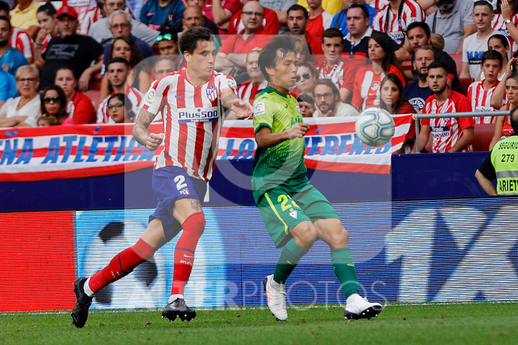 Jose Maria Gimenez of Atletico de Madrid and Takashi Inui of SD Eibar in action during La Liga match between Atletico de Madrid and SD Eibar at Wanda Metropolitano Stadium in Madrid, Spain.September 01, 2019. (ALTERPHOTOS/A. Perez Meca)
