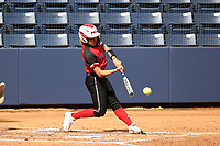 GREENSBORO, NC - MARCH 11: Kenny Litana #12 of Northern Illinois University hits the ball during a game between Northern Illinois and UNC Greensboro at UNCG Softball Stadium on March 11, 2020 in Greensboro, North Carolina.