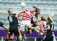 Newcastle, England - Friday, August 3, 2012: The USA women defeated New Zealand 2-0 in the quarterfinal round of the 2012 Olympics at St. James Park. Abby Wambach heads the ball towards goal.