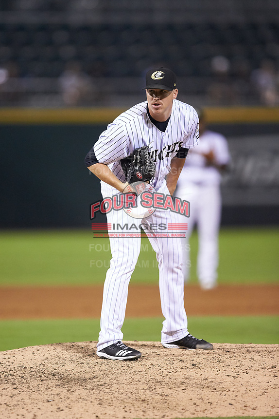 Charlotte Knights relief pitcher Colton Turner (14) looks to his catcher for the sign against the Durham Bulls at BB&T BallPark on July 31, 2019 in Charlotte, North Carolina. The Knights defeated the Bulls 9-6. (Brian Westerholt/Four Seam Images)