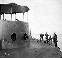 The Original Monitor after her Fight with the Merrimac.  Near the port-hole can be seen the dents made by the heavy steel-pointed shot from the guns of the Merrimac.  Hampton Roads, VA, July 1862.  Stereo.  (National Archives Gift Collection)<br /> Exact Date Shot Unknown<br /> NARA FILE #:  200-CC-486<br /> WAR & CONFLICT BOOK #:  183