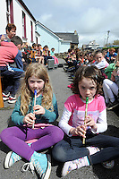 1-5-2014:Niamh Nic Dhomhaill, left and Caitliona NicCarthaigh from Ballyferriter pictured performing with their classmates at the opening day of Feile na Bealtaine in Ballyferriter, Dingle  County Kerry on Thursday. The festival runs until May 5th and more details on www.feilenabealtaine.ie.<br /> Photo: Don MacMonagle<br /> <br /> <br /> REPRO FREE FROM FEILE NA BEALTAINE