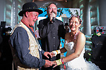 "© Joel Goodman - 07973 332324. 06/08/2017 . Macclesfield , UK . Wedding ceremony for Debbie and Andrew Tideswell , 47 and 56 respectively, from Northwich, ""officiated"" by ""Revd Duncan Pritchard"" at an inflatable church . The couple met in the queue at the festival last year . The Rewind Festival , celebrating 1980s music and culture , at Capesthorne Hall in Siddington . Photo credit : Joel Goodman"