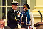 WATERBURY, CT. 20 December 2019-122019BS247 - Waterbury Fire Chief Terry Ballou, left, reacts after being given a gift by Congresswoman Jahana Hayes, during the swearing in ceremony for Waterbury Fire Chief at City Hall on Friday. Terry Ballou replaces former Fire Chief David Martin, who retired earlier this year. Bill Shettle Republican-American