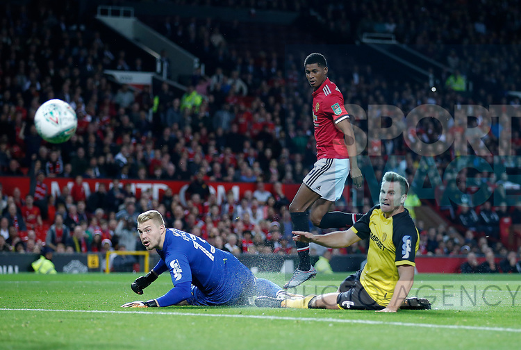 Marcus Rashford of Manchester United scores the first goal past Connor Ripley of Burton Albion during the Carabao Cup Third Round match at the Old Trafford Stadium, Manchester. Picture date 20th September 2017. Picture credit should read: Simon Bellis/Sportimage