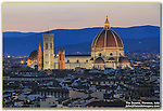 Italy, Florence.   <br /> It was a hot, hazy day ending in a boring sunset. You're best chance is to photograph at just the right time - when the city lights first come on and there's still detail in the surroundings. The Duomo Cathedral at sunset, Florence, Italy.