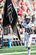 College Park, MD - SEPT 23, 2017: UCF Knights Running Back  Greg McCrae (30) leads his team onto the field carrying the UCF team flag during game between Maryland and UCF at Capital One Field at Maryland Stadium in College Park, MD. (Photo by Phil Peters/Media Images International)