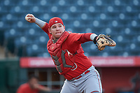 Catcher Marlon Marcano (8), of the AZL Angels, throws to first base during an Arizona League game against the AZL Padres 1 on August 5, 2019 at Tempe Diablo Stadium in Tempe, Arizona. AZL Padres 1 defeated the AZL Angels 5-0. (Zachary Lucy/Four Seam Images)