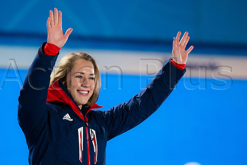 15.02.2014 Sochi, Krasnodar Krai, Russia.   A tearful Lizzy YARNOLD (GBR) climbs onto the top step of the podium to receive her Gold medal during the Medal Ceremony for the Women's Skeleton at the Sochi Medals Plaza, Coastal Cluster - XXII Olympic Winter Games
