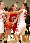 SIOUX FALLS, SD - JANUARY 6:  Izzy VanVeldhuizen #20 from Lincoln looks for a teammate between Madison Aasen #34 and Carly Knutson #42 from Washington in the second half of their game Tuesday night at Washington High School. (Photo by Dave Eggen/Inertia)