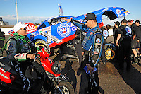 Jan 30, 2008; Chandler, AZ, USA; NHRA funny car driver Robert Hight (right) talks with team owner John Force after an incident during testing at the National Time Trials at Firebird International Raceway. Mandatory Credit: Mark J. Rebilas-
