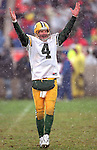 Green Bay Packers quarterback Brett Favre (4) celebrates during an NFL football game against the Chicago Bears at Soldier Field on December 5, 1999 in Chicago, Illinois.  The Packers won 35-19. (Photo by David Stluka)