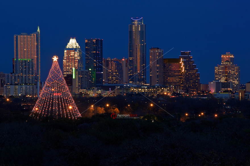 A tradition since 1967, the annual lighting of the Zilker Tree is one of the Austin's most popular and recognized events.It's not technically a tree but rather one of the original Moonlight Towers (Austin's first illumination system, way back in 1894, consisted of 31 carbon-arc lamps on 150 foot tall wrought iron poles). The Zilker Tree is constructed of 39 streamers which hold 3300 individual bulbs in a spiral design. There is also a large, double star comprised of 150 individual frosted bulbs.