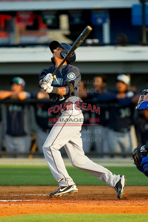Gabriel Franca (3) of the Pulaski Mariners follows through on his swing against the Burlington Royals at Burlington Athletic Park on June20 2013 in Burlington, North Carolina.  The Royals defeated the Mariners 2-1 in 13 innings.  (Brian Westerholt/Four Seam Images)